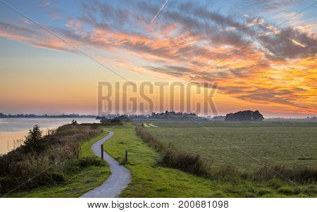 Polder Landscape With Winding Cycling Track
