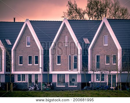 Row Of Modern Houses At Sunset Vintage Colors