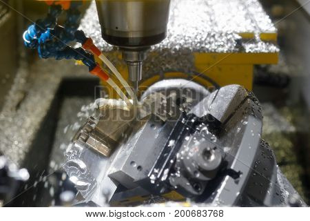 Milling metalworking process by CNC vertical milling center. Selective focus. poster