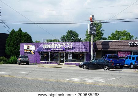 CREST HILL, ILLINOIS / UNITED STATES - JULY 19, 2017: One may sign up for Metro PCS prepaid wireless service, and enjoy unlimited calls to Mexico, from an authorized dealer on Plainfield Road.