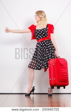 Woman With Red Suitcase Hitchhiking