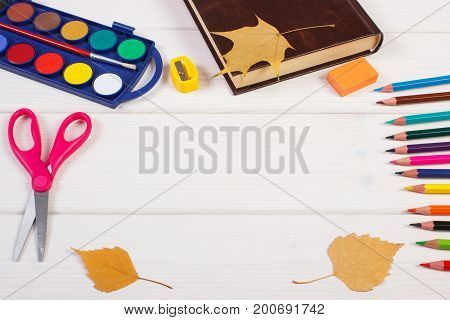 Frame Of Accessories For Learning And Teaching, Book And Autumnal Leaves On Boards, Back To School C