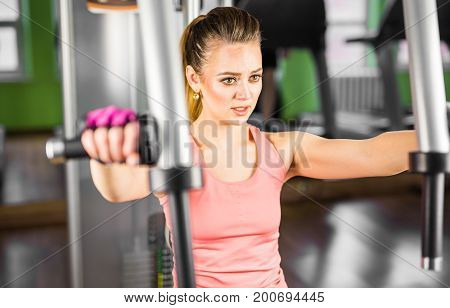 fitness, sport, powerlifting and people concept - sporty woman doing workout in gym