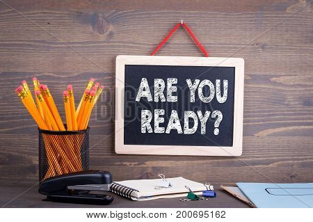 Are You Ready. Chalkboard on a wooden background.