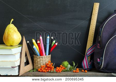 School supplies with empty blackboard background concept