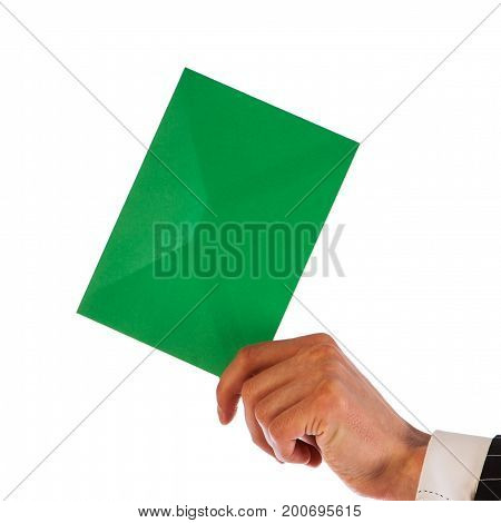 Businessman holds a green envelope isolated on a white background