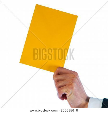 Businessman holds a yellow envelope isolated on a white background
