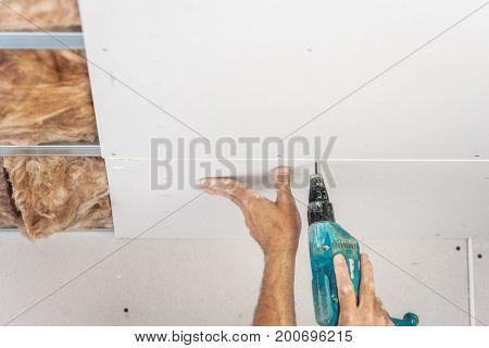 Workers are assembly gypsum wall. Plasterboard gypsum