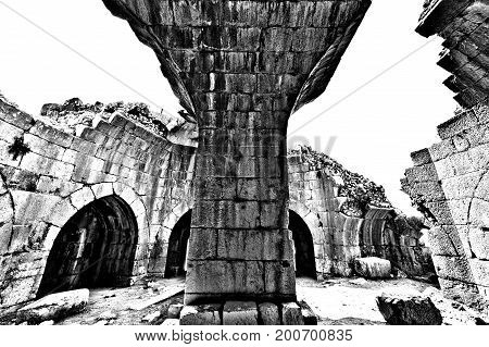 Remnants of castle on the Golan Heights near the Israeli border with Syria. The Nimrod Fortress National Park of Israel on the slopes of mount Hermon. Black and white picture