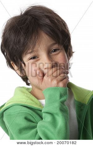 Little boy laughing behind his hand