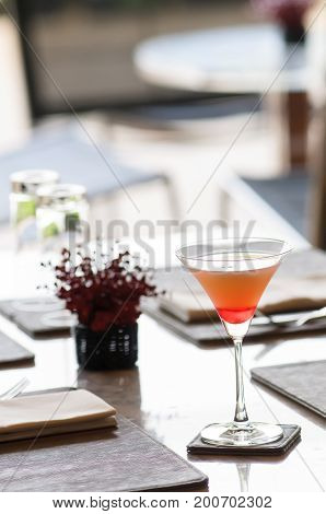A glass of watermelon cocktail welcome drink ready for you on the table