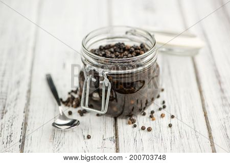 Black Peppercorns, Preserved, On Wooden Background