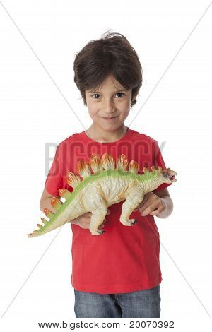 Little boy is showing his toy dinosaur