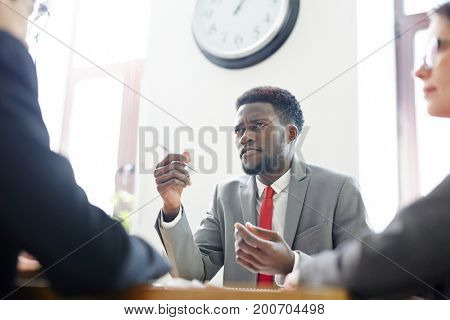 Young specialist speaking about himself to employers at interview