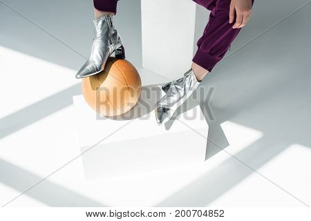 Woman In Silver Colored Boots