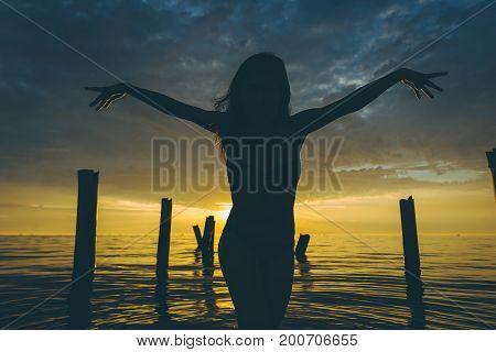 ballet dancer water sunset pose beautiful female