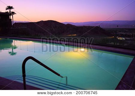 Swimming Pool overlooking the Coachella Valley during dusk taken in Palm Springs, CA poster