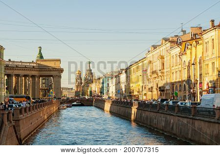 ST PETERSBURG RUSSIA - AUGUST 15 2017. Historic landmarks along the Griboedov channel in St Petersburg Russia. Architecture landscape of St Petersburg Russia in sunset