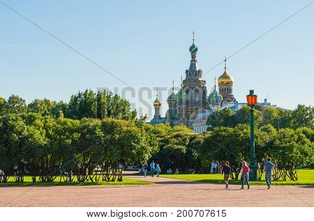 ST PETERSBURG RUSSIA - AUGUST 15 2017.The Field of Mars - large park in center of St Petersburg Russia and Cathedral of Our Savior on Spilled Blood in St Petersburg Russia