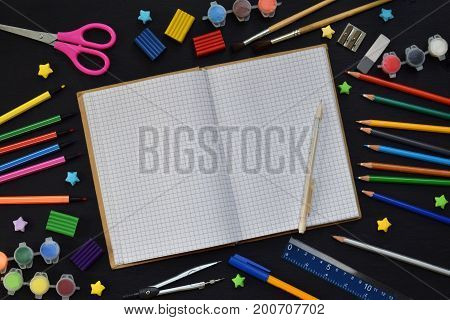 School Accessories And Supplies: Pencils, Markers, Paints, Pens, Blackboard For Inscriptions On A Da