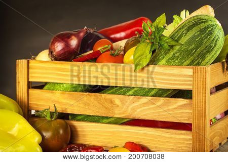 Vegetables in a wooden box. Sales of vegetables on farm markets. Agricultural products
