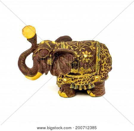 Photo of statuette of brown elephant with yellow sapphire isolated on a white background