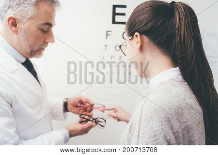 Woman Choosing A Pair Of Glasses