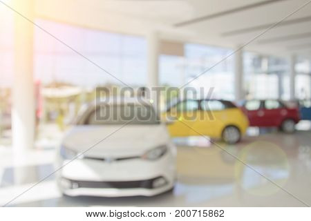 Blur The Background Of The Car And Showroom At Blurred In Workplace Or Abstract Background Of Shallo