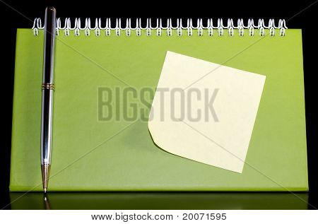 Organizer with pen and noteped