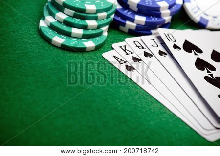 Poker chips and a straight flush card hand with copy space for your text