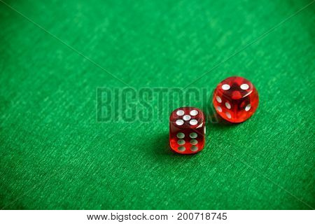Red poker dices on casino table background