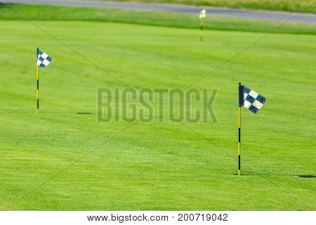 Golf course in the countryside flag at the beautiful golf course