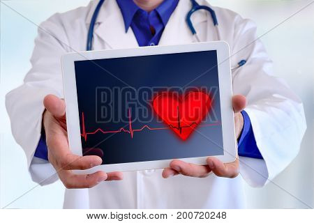 Caucasian General Doctor Showing Tablet With Electrocardiogram Representation Concept