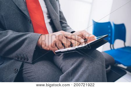 Businessman Connecting With A Tablet
