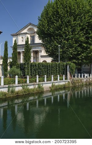 Gorgonzola (Milan Lombardy Italy): the canal of Martesana and church of saints Gervaso and Protaso