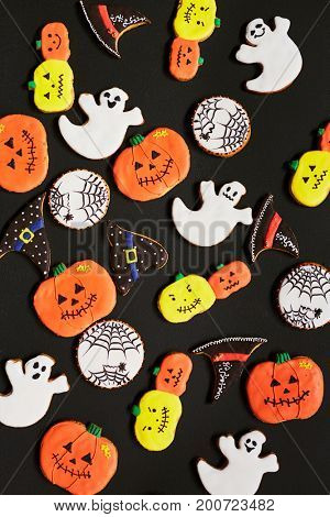 Halloween background with funny cookies in form of ghost, pumpking, hat and net