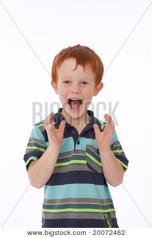 Red Head Boy With Shocked And Surprised Expression On Face