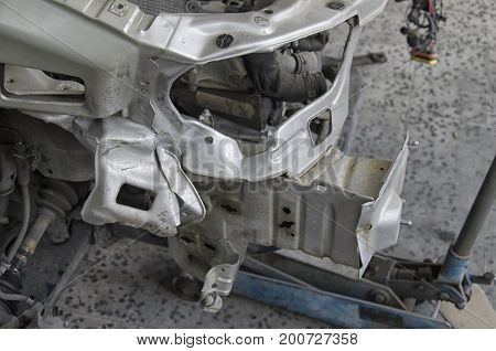 View of an incidented car in the auto mechanic