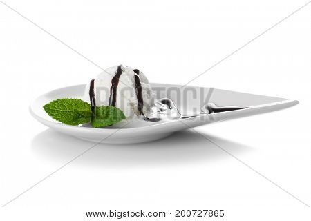 Plate with delicious ice-cream and chocolate sauce on white background