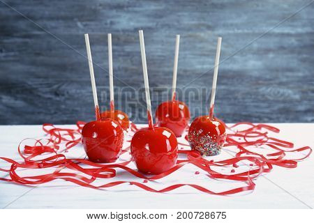 Delicious candy apples on table