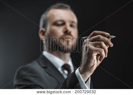 Caucasian Businessman With Pen