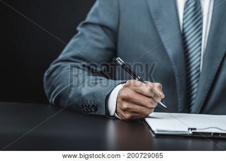 Businessman Doing Paperwork
