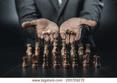 African American Businessman Holding Chess Figures