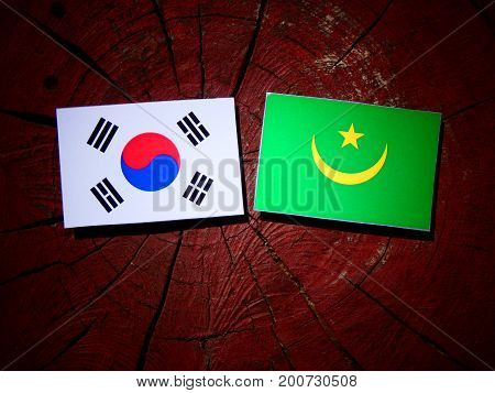 Mauritania Flag With South Korean Flag On A Tree Stump Isolated
