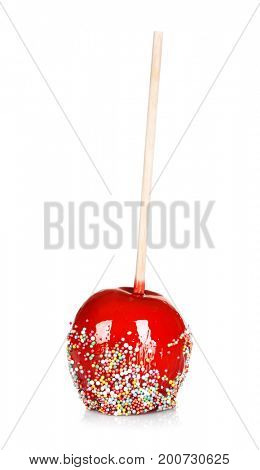Delicious candy apple on white background