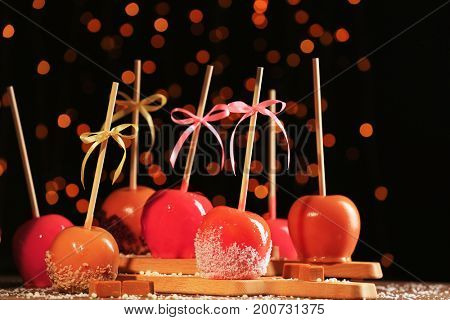 Delicious caramelized apples on blurred background