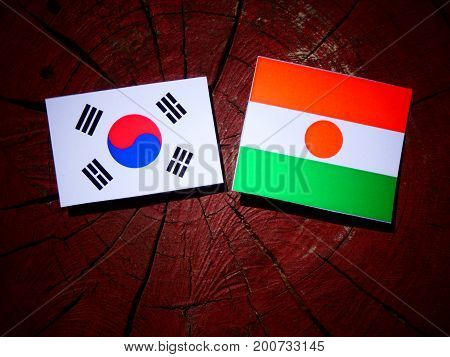 Niger Flag With South Korean Flag On A Tree Stump Isolated
