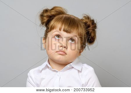 Portrait of thoughtful little girl isolated on white