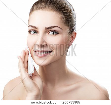 Young woman cleaning her face by napkins. Skincare concept. Maku-up removal napkins. Isolated on white.