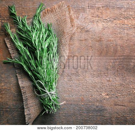Fresh rosemary on wooden background